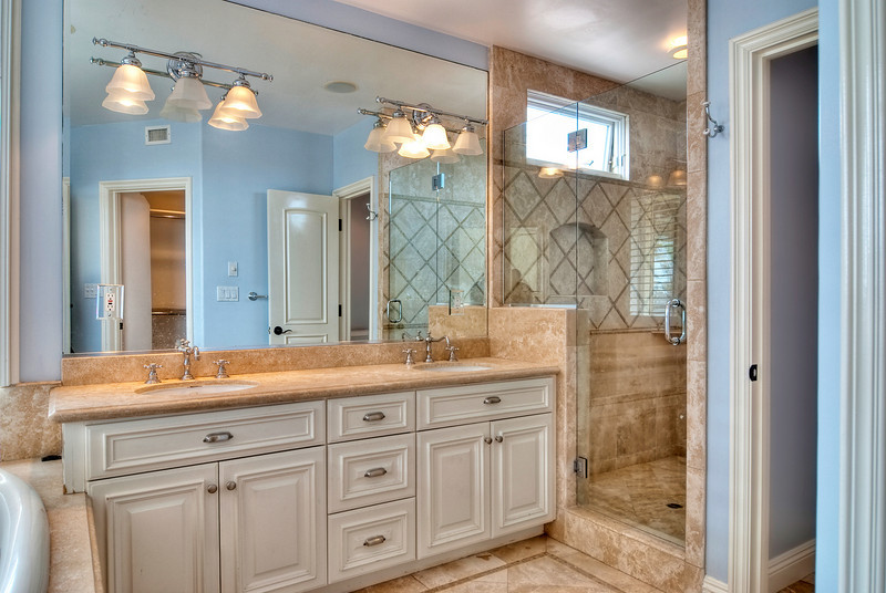 dual master bathroom sinks and glass shower